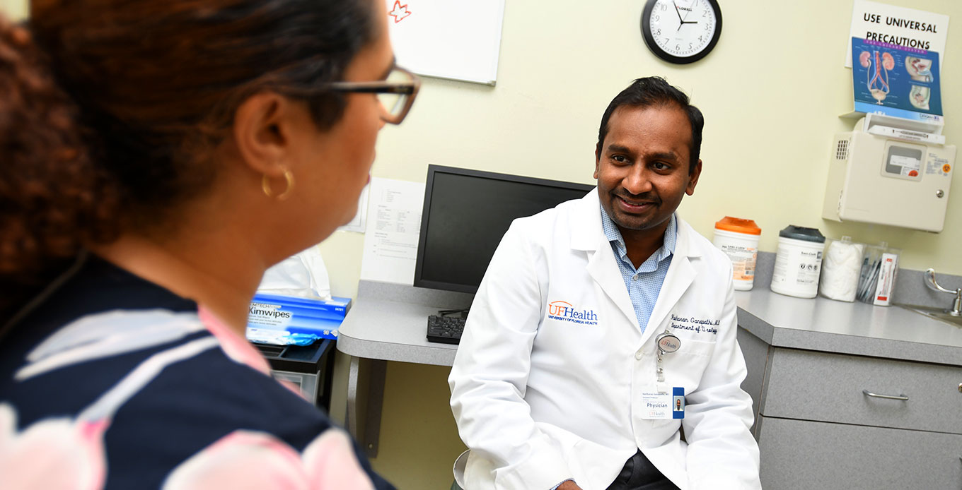 University of Florida urologist with patient at UF Health Jacksonville